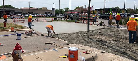 UMC Concrete construction crew installing concrete